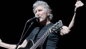 Roger Waters, bassist from the Rock group Pink Floyd, gestures during a performance of The Wall at the Bercy POPB concert hall in Paris on May 30, 2011. AFP PHOTO BERTRAND LANGLOIS (Photo credit should read BERTRAND LANGLOIS/AFP/Getty Images)